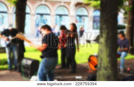 Street Musicians Playing Nice Musik On The Streets Under The Trees