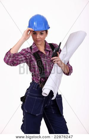 young female worker holding talkie-walkie and plan