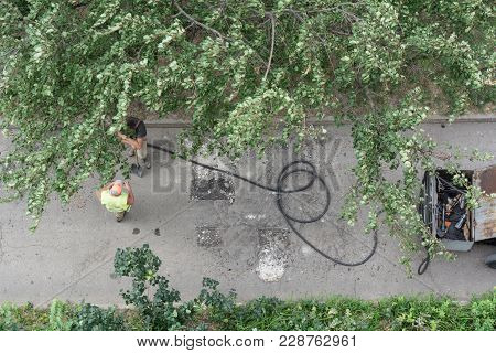 Road Repair. Workers Are Repairing The Asphalt In The Yard, Top View.