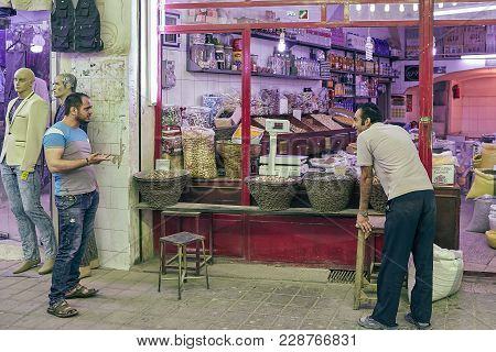 Kashan, Iran - April 25, 2017: Iranian Grocer In The Grocery Department Is Talking With Buyer And Sm