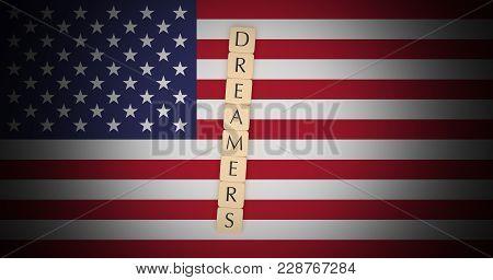 Usa Politics Immigration News Concept: Letter Tiles Dreamers On Us Flag, 3d Illustration