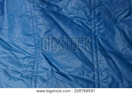 Blue Texture Of Synthetic Fabric From A Fragment Of Crumpled Clothes