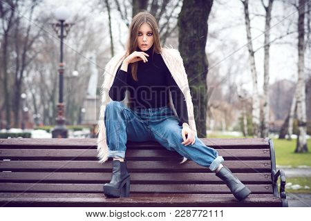 Girl In Casual Fashion Clothes. On The Street There Is Snow. Gloomy Makeup. Fashionable Woman. Casua