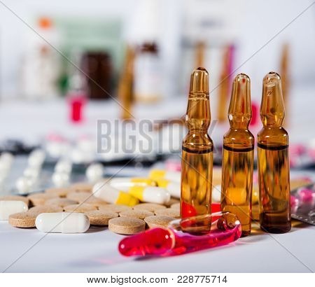 On The Table There Are Ampoules Next Different Pills Drugs And Medications. With Copy Space For Your