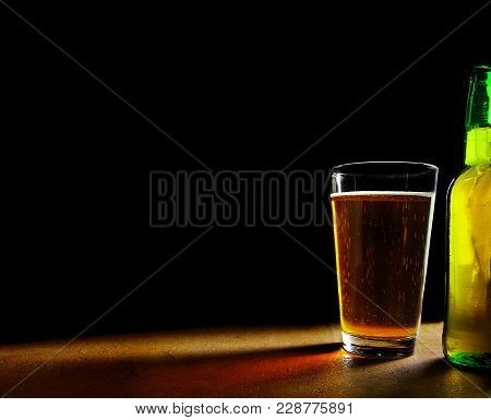 Pint Of Craft Beer And Bottle, On Black Background With Copy Space
