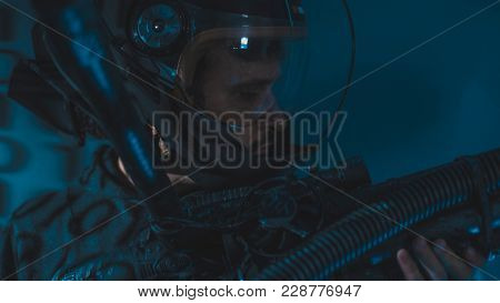 space man with led lights helmet, space suit and gun in the shape of a cannon