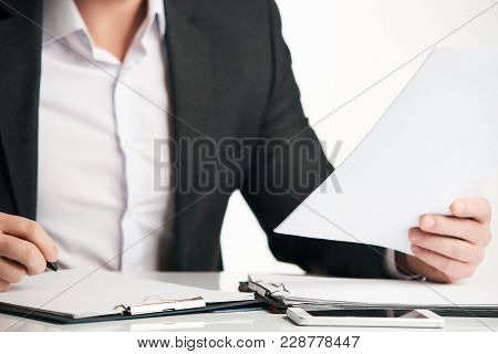 Confident Happy Businessman Signing Contract At His Desk Isolated On White Background. Business Man