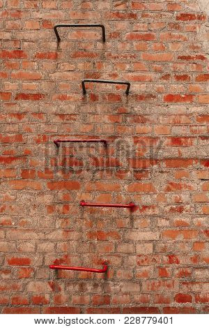 Dirty Red Brick Wall And Ladder. Retro. Ukraine