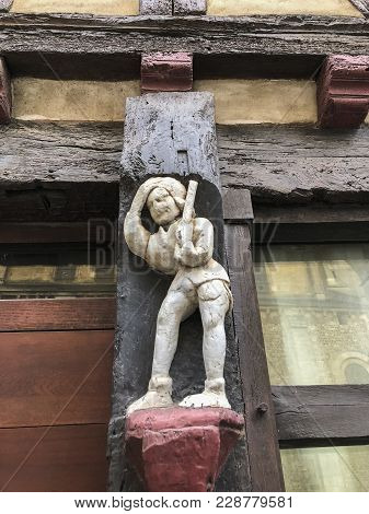 Old Wooden Sculpture Of 15th Century On A House In A Medieval City Le Mans, France