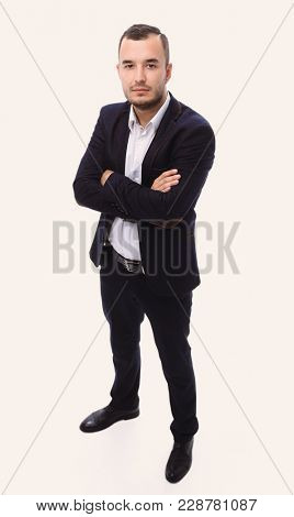in full growth. confident businessman looking at the camera