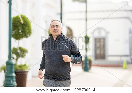 Good Looking And Active Mature Man Going For A Run In The City And Exercising