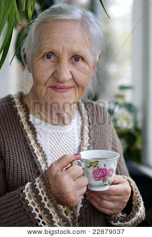 Elderly woman with cup of tea