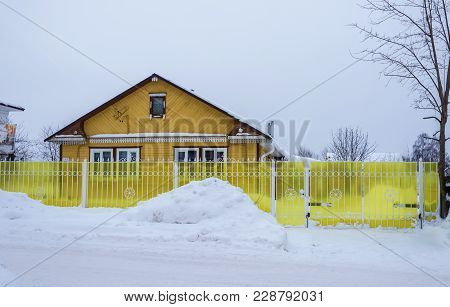 A Small Wooden House With A Bright Yellow Fence February 17, 2018 In The Village Of Vyatskoye, Yaros