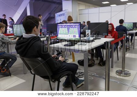 ST. PETERSBURG, RUSSIA - FEBRUARY 23, 2018: Gamers in the cyber-football zone during St. Petersburg Cyber-Sport Festival. Main event of the festival is the Counter-Strike: Global Offensive tournament