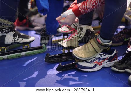ST. PETERSBURG, RUSSIA - FEBRUARY 16, 2018: Athletes tie the laces on skates during short track speed skating competitions Pavlovsky Cup. Athletes from 6 countries participated in the competitions