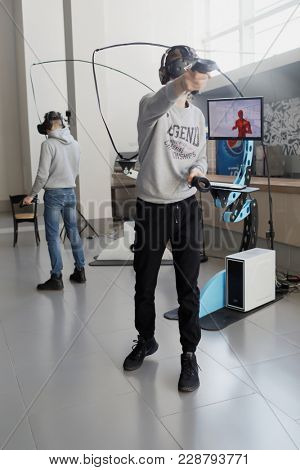 ST. PETERSBURG, RUSSIA - FEBRUARY 22, 2018: People in virtual reality zone during St. Petersburg Cyber-Sport Festival. Main event of the festival is the Counter-Strike: Global Offensive tournament