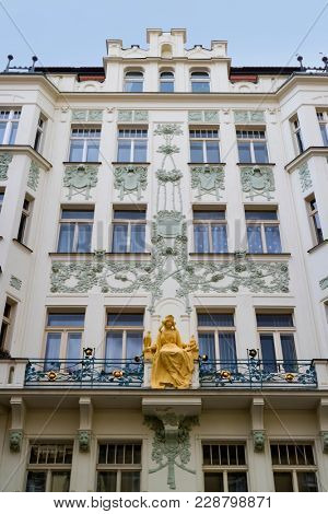 Prague, Czech Republic - October 9, 2017: An Art Nouveau female figure, Princess Libuse statue, on a balcony of a facade in Karlova