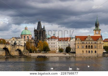 Prague, Czech Republic - October 9, 2017: Classic Czech buildings and Smetana Museum along the Vltava River in Prague in autumn