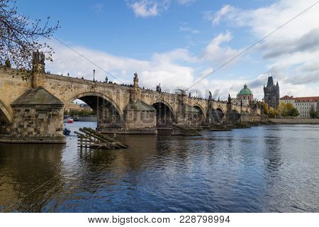 Prague, Czech Republic - October, 6, 2017: Charles Bridge, UNESCO World Heritage Site, pedestrian bridge over the Vltava river with at the end the bridge tower
