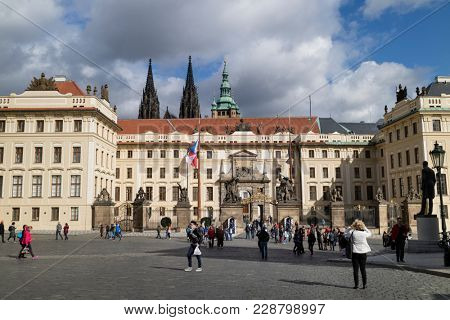 Prague, Czech Republic - October, 6, 2017: Entrance gate of Prague castle seen from  Hradcany Square with three towers in the background