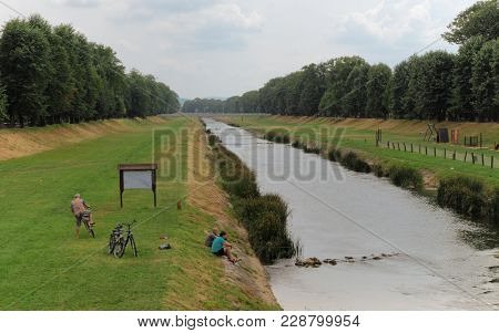 PIROT, SERBIA - JULY 27, 2017: cloudy and gloomy day on green quay by Nisava river in Pirot town, Serbia