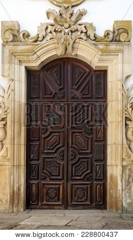 Vila Real, Portugal - September 22, 2017: Entrance Hand Carved Wood Door To The Baroque Chapel Of Th