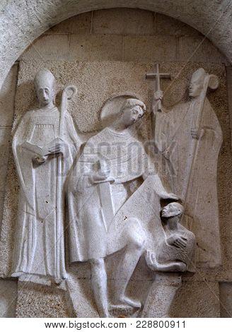 MUNSTERSCHWARZACH, GERMANY - JULY 09, 2017: Saints Burkard bishop of Wurzburg, Willibald bishop of Eichstatt and Martin of Tours, altar in Munsterschwarzach Abbey, Benedictine monastery, Germany.