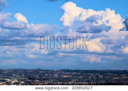 Cumulus clouds during atmospheric instability above an urban landscape taken in the Los Angeles Metropolitan Area poster