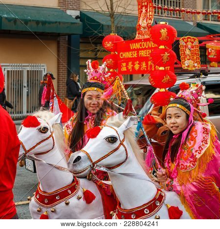 Vancouver, Canada - February 18, 2018: People On Horses At Chinese New Year Parade In Vancouver Chin