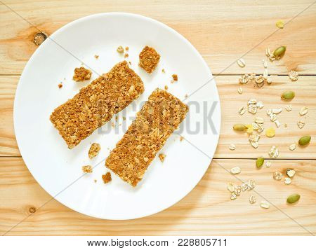 Cereal Bars Or Flapjacks Made From Rolled Oats With Crumbs On White Plate. Top View.
