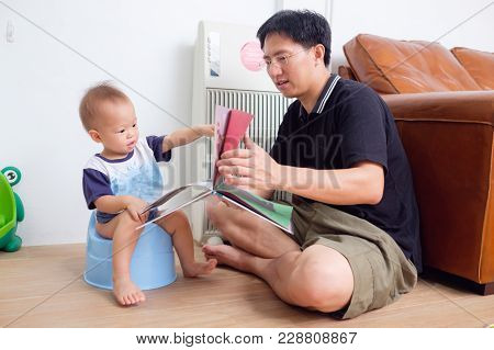 Father Training His Son To Use Potty, Cute Little Asian 1 Year Old / 18 Months Toddler Baby Boy Chil