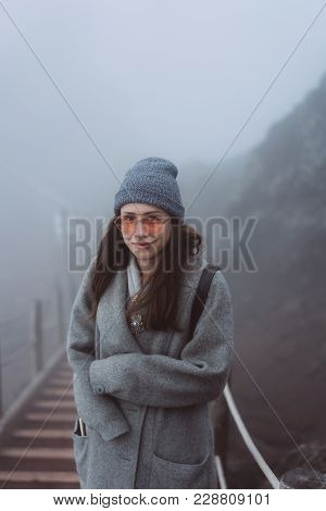 Beautiful Young Girl Climbs The Path To The Mountain