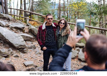 Guy And Girl Are Posing On Camera In The Woods