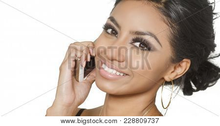Smiling happy friendly young woman using phone