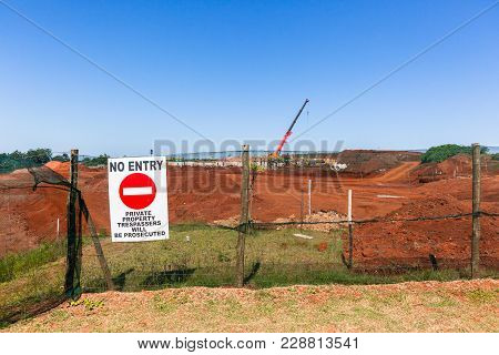Construction Earthworks Landscape No-entry Sign On Fence Towards New Building Housing Engineering Pr