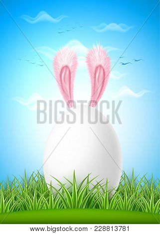 Realistic Easter White Egg Hare Pink Ear On Green Grass Meadow Field On Blue Cloud Summer Sky Backgr