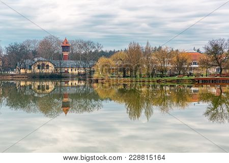 Beautiful Lake With Mirror Reflections In Clear Water On Cloudy Day. Tranquil Landscape With Lake, H