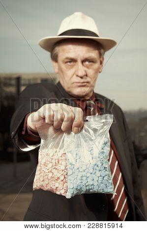Older Dealer Of Narcotics Selling Extasy Drugs On Street