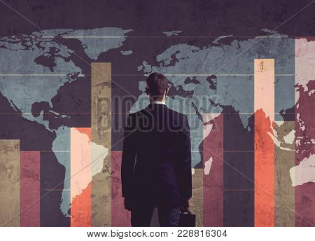 Businessman Standing Over Diagram. World Map Background. Business, Office, Career Concept