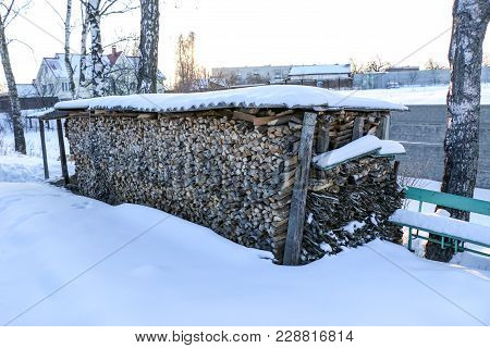 Neatly Stacked Firewood To Kindle The Furnace, Winter Ukraine