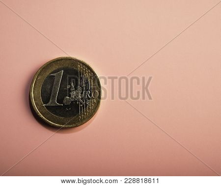 Coin One Euro On A Pink Background. Business Metaphor. Conceptual.