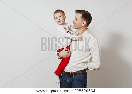 Happy Father's Day. Handsome Joyful Smiling Young Man Holding And Hugging Little Cute Child Boy Isol