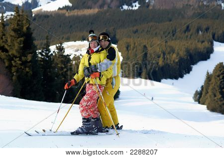 Yong Family Skiers In Yellow On Ski Slope
