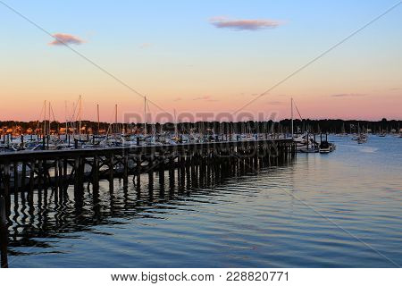 Dusk In  A Salem, Massachusetts Harbor And Calm Waters.