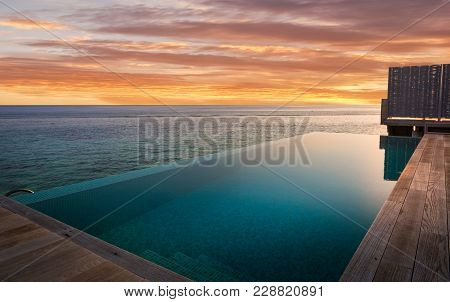 Private Swimming Pool And Amazing Sunset In Maldives