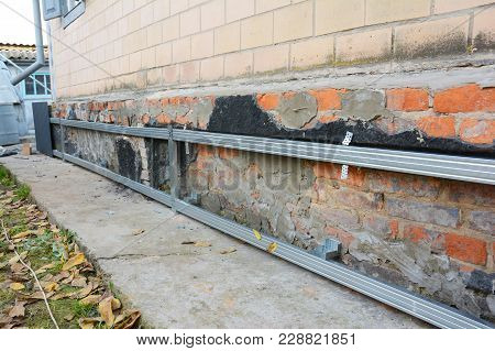 Old House Foundation Wall Repair,  Renovation  With Installing Metal Sheets On Metal Frame For Water