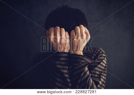 Distraught State Of Mind, Depressive And Sad Man In Dark Room