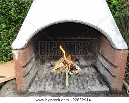 The Barbecue Is A Cooking Appliance. Food Is Placed On A Railing Or On A Brooch And Are Exposed To T