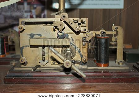 Old Morse Key Telegraph On Wooden Table