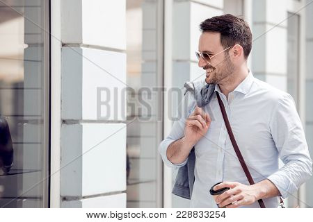 Young Successful Business Man Walking In The City